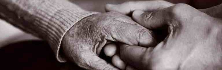 Old and young hands grasping one another